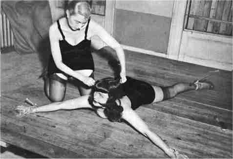 Bettie Page spreadeagled on the floor