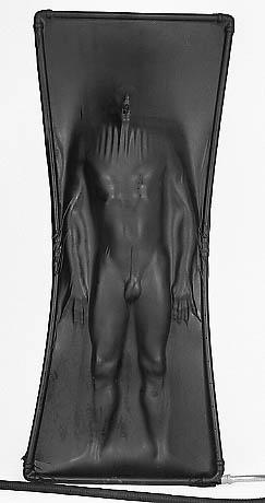 Male body inside vacuum bed