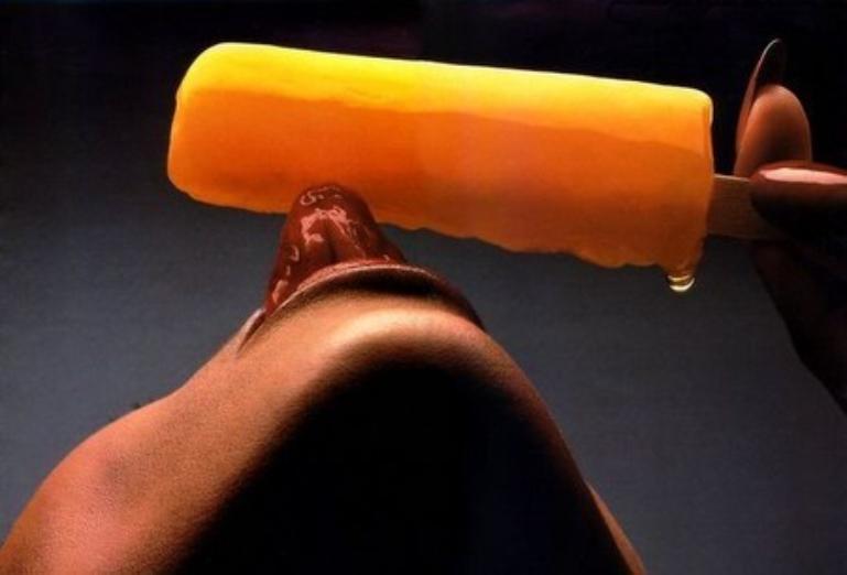 woman licking a lollipop