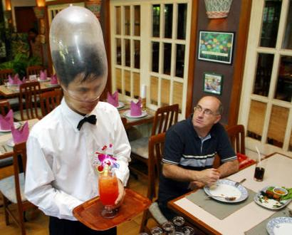 waiter with condom on head
