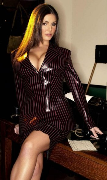 Woman in a latex business suit