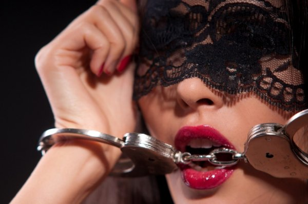 Blindfolded girl with cuffs