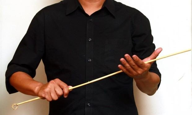 Teacher with cane